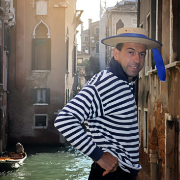 'Gondolier In Venice Italy' by Photographer Debbi Nelson. © Copyright 2016 Debbi Nelson dba Photograzia