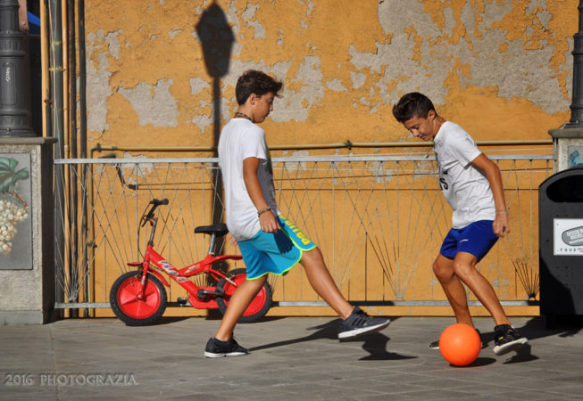 """Italian Boys Playing Ball"" by Photographer Debbi Nelson. © Copyright 2016 Debbi Nelson dba Photograzia"